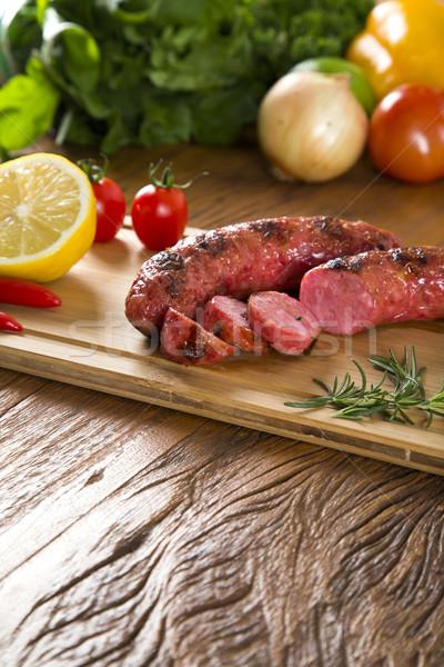 Grillezett hús kolbászok krumpli paradicsomok grillezett grill Stock fotó © paulovilela