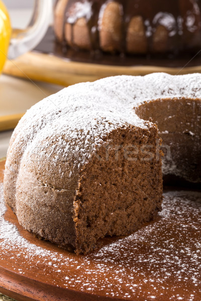 Chocolate cake on the table with carrot cake in the background. Stock photo © paulovilela