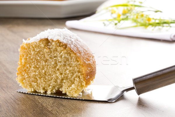 coconut cake with slice on the table Stock photo © paulovilela