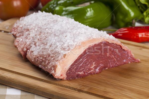 Nyers steak fa deszka zöldségek piros hús Stock fotó © paulovilela