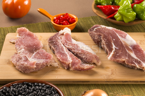Pig loin raw in wooden background Stock photo © paulovilela