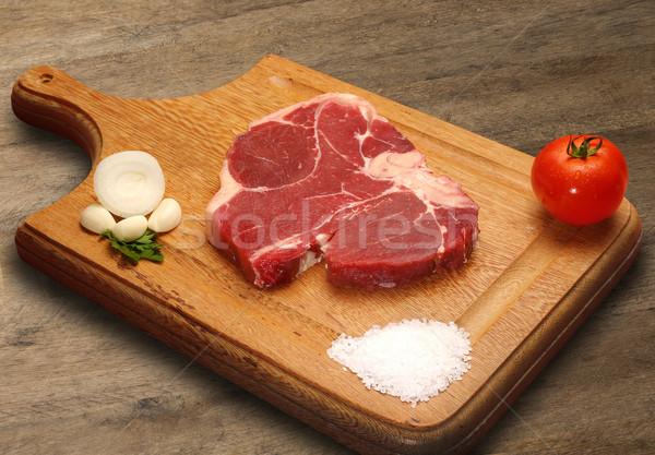 Nyers hús fából készült vágódeszka papír étel Stock fotó © paulovilela