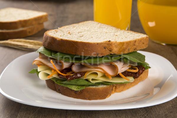 Sandwich on a white plate with turkey breast, tomato, lettuce an Stock photo © paulovilela