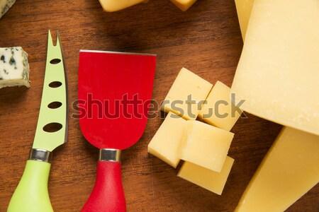 Parmesan planche à découper délicieux alimentaire fond bleu Photo stock © paulovilela