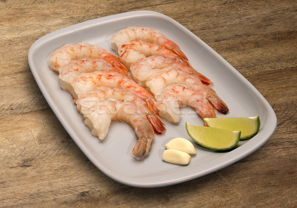 closeup of a plate with shelled raw shrimps Stock photo © paulovilela