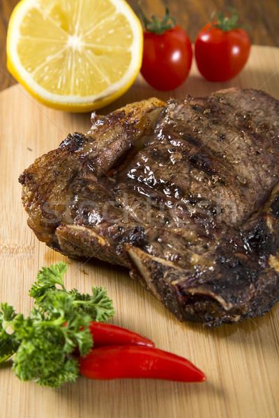 Grillezett hús borda fehér tányér paradicsomok snidling Stock fotó © paulovilela