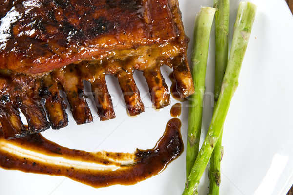 Tasty grilled ribs with vegetables  Stock photo © paulovilela