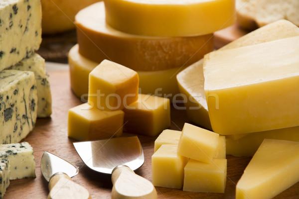 Diferente tabla de cortar delicioso alimentos fondo azul Foto stock © paulovilela
