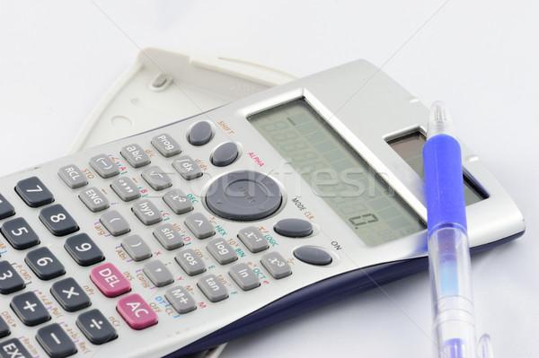 Geïsoleerd calculator pen witte kantoor papier Stockfoto © paulwongkwan