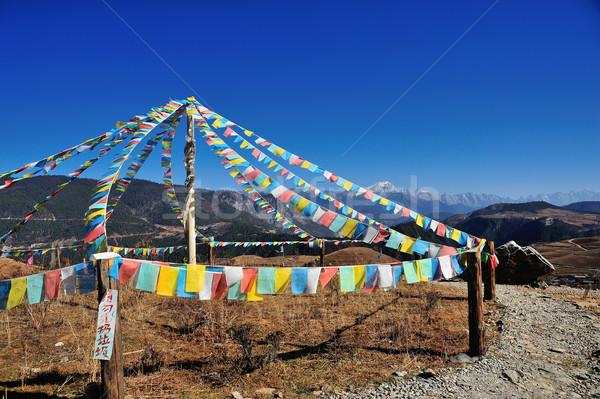Stock photo: Prayer flag with mountain