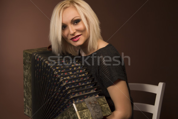 young woman with with an accordion Stock photo © Pavlyuk