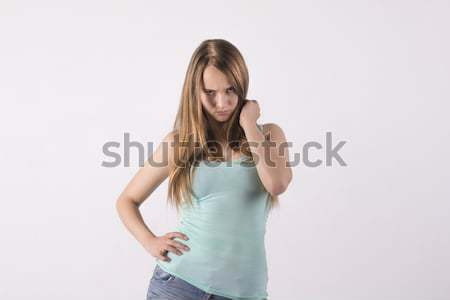 Offended young woman Stock photo © Pavlyuk