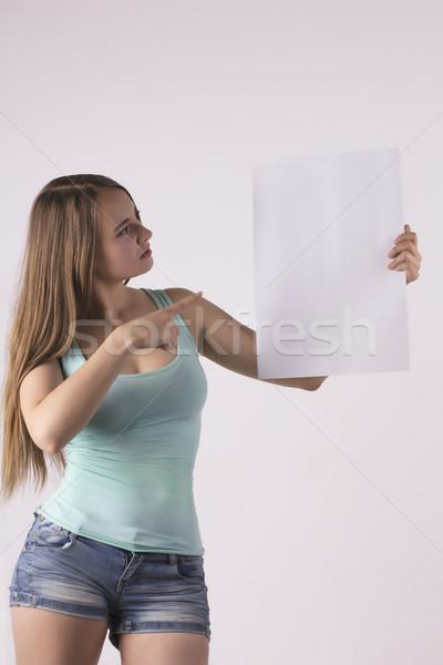 young woman indicate poster Stock photo © Pavlyuk