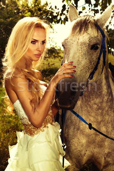 Portrait of gorgeous blonde girl with horse. Stock photo © PawelSierakowski