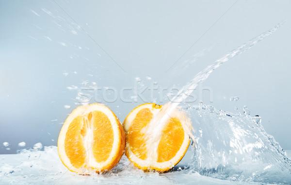 Slices of orange thrown water  Stock photo © PawelSierakowski