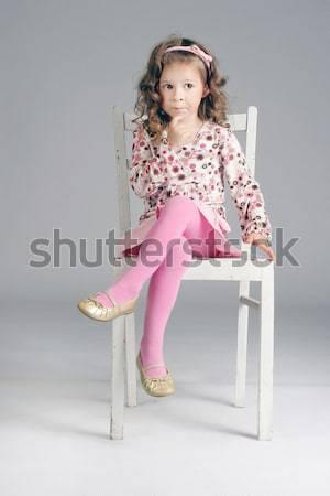 Słodkie zamyślony dziewczynka posiedzenia biały krzesło Zdjęcia stock © PawelSierakowski