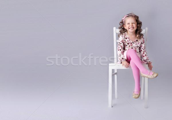 Petite fille séance président sourire espace de copie Photo stock © PawelSierakowski