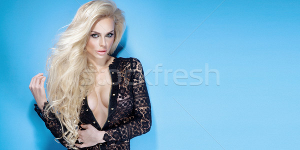 Attractive young woman with magnificent blond hair. Stock photo © PawelSierakowski