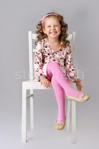 Cute little child sitting on the chair and smiling Stock photo © PawelSierakowski