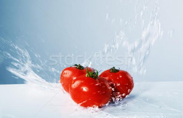 Juicy tomatoes thrown water Stock photo © PawelSierakowski