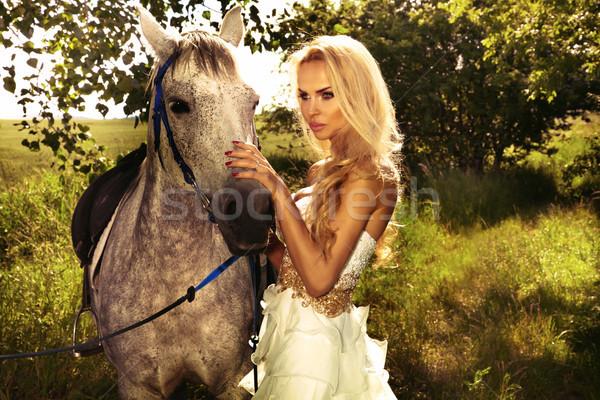 Beautiful blonde lady with posing with horse. Stock photo © PawelSierakowski