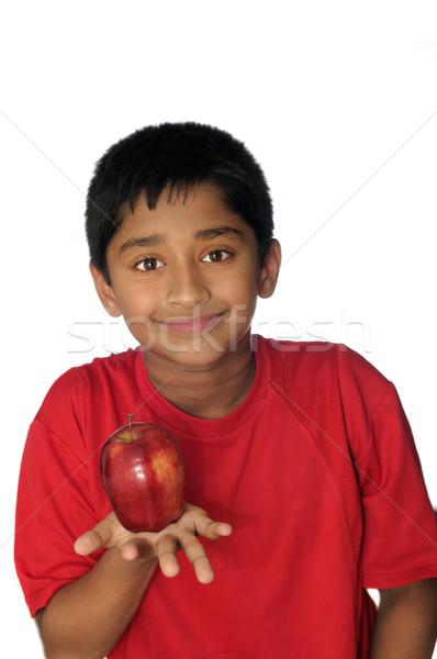 Pomme élégant indian Kid manger jour Photo stock © pazham