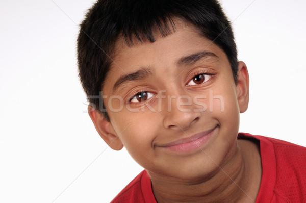 Mosolyog fotó imádnivaló fiatal srác néz kamera Stock fotó © pazham