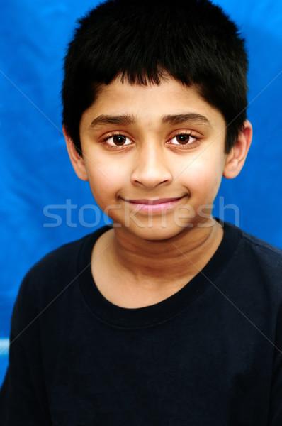 Mosolyog jóképű indiai gyerek néz boldog Stock fotó © pazham