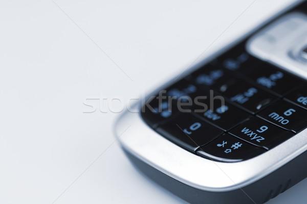 Telefonu komórkowego pierwszy plan niebieski działalności technologii telefon Zdjęcia stock © pedrosala