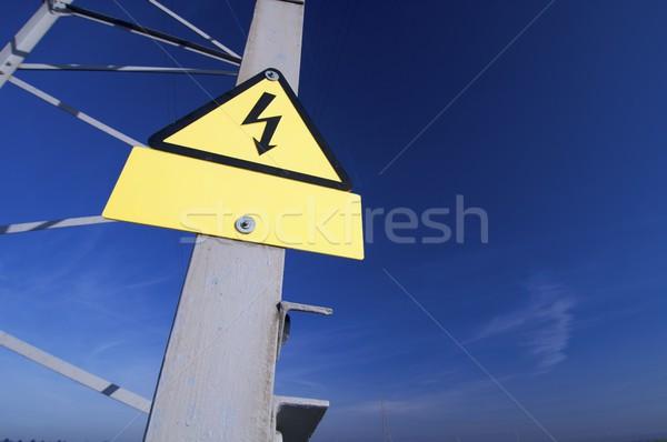 высокое напряжение знак опасность небе металл синий Сток-фото © pedrosala