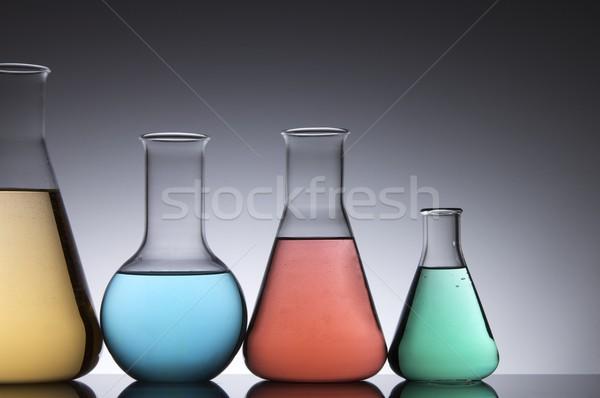 Laboratórium négy üvegek színes folyadék fehér Stock fotó © pedrosala