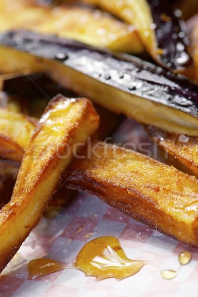 Eggplant dish with honey Stock photo © pedrosala