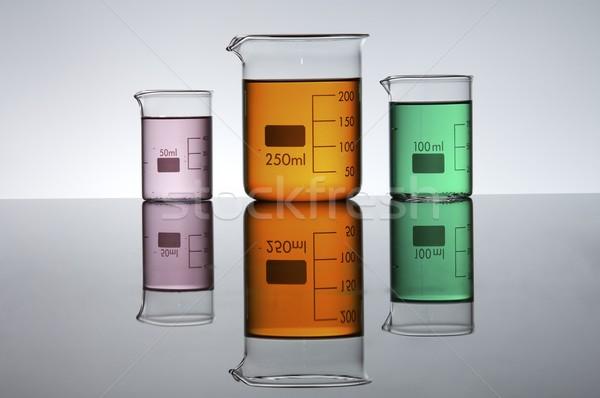 Három színes folyadék fényes fehér üveg Stock fotó © pedrosala