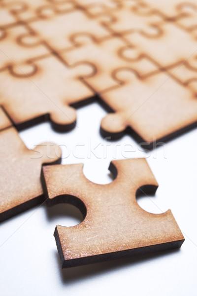 Puzzle közelkép darabok fa háttér csapat Stock fotó © pedrosala