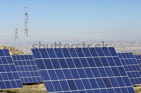 Fotovoltaïsche reusachtig zonne veld hoog spanning Stockfoto © pedrosala