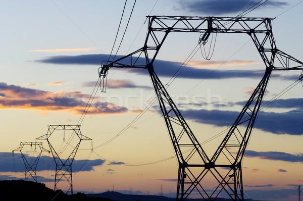 Elektrische oranje hemel zonsopgang wolken metaal Stockfoto © pedrosala
