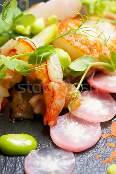 Piglet scallops and prawns. Stock photo © pedrosala