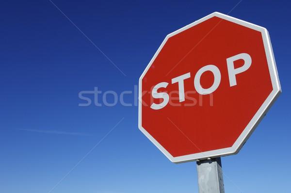 Stoppen stopteken blauwe hemel hemel auto weg Stockfoto © pedrosala