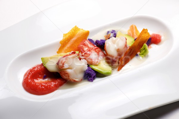 Lobster with sauce and vegetables Stock photo © pedrosala