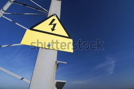 Alta tensione segno pericolo cielo metal campo Foto d'archivio © pedrosala
