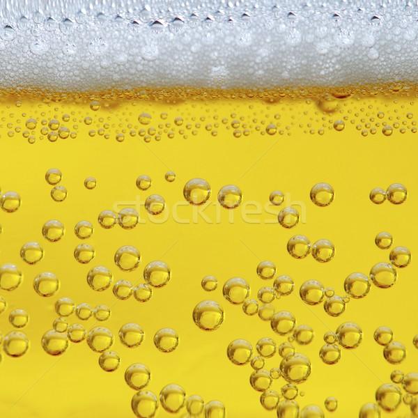 Cerveza primer plano vista burbujeante resumen luz Foto stock © pedrosala