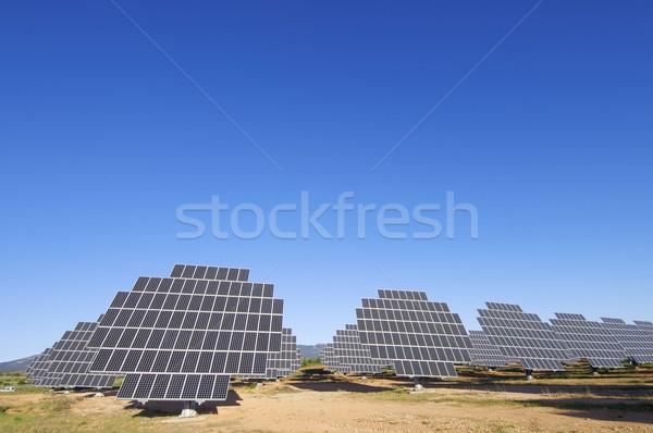 Fotovoltaikus mező kék ég technológia csoport ipar Stock fotó © pedrosala