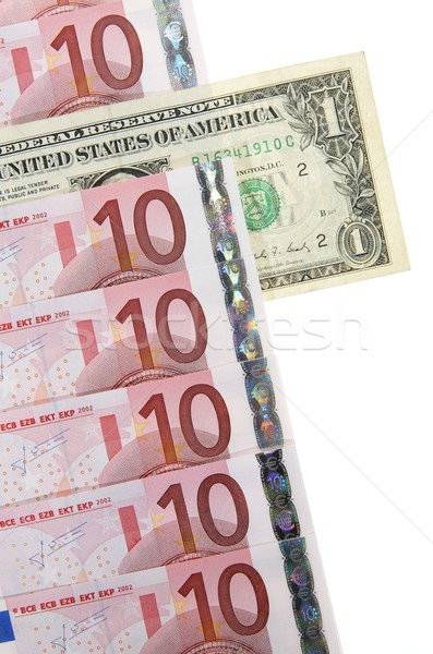 Confrontation une dollar Bill sur groupe Photo stock © pedrosala