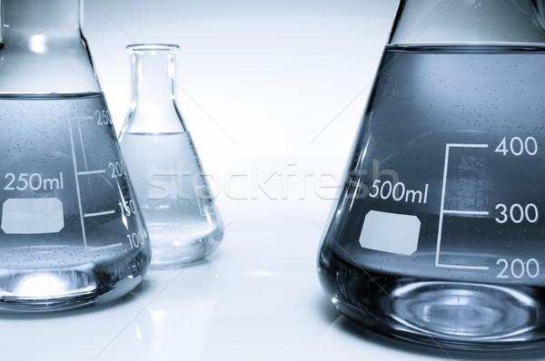 Três líquido azul branco vidro fundo Foto stock © pedrosala