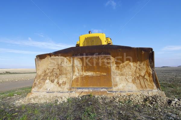 Buldózer citromsárga mező kék ég Föld ipari Stock fotó © pedrosala