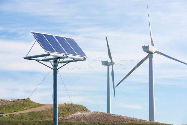 Energie rinnovabili mulino a vento fotovoltaico pannello energia produzione Foto d'archivio © pedrosala