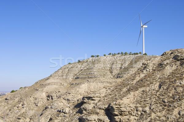 Eenzaam windmolen heuvel hemel landschap technologie Stockfoto © pedrosala