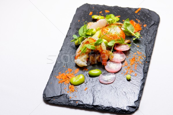 Piglet scallops and prawns. Stock photo © pedrosala