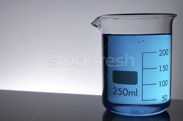 химический стакан синий жидкость фон медицина промышленности Сток-фото © pedrosala
