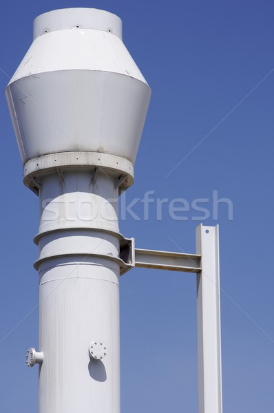 Beyaz Metal baca endüstriyel mavi gökyüzü gökyüzü Stok fotoğraf © pedrosala